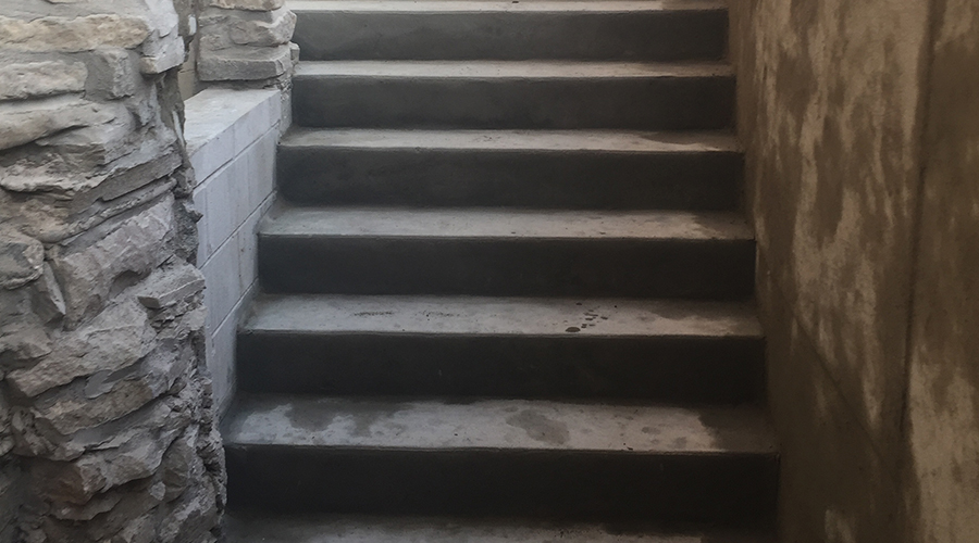Concrete stairs built for a basement walkout by Mace Masonry