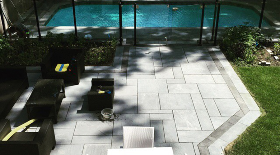 Stone patio and pool deck built by Mace Masonry