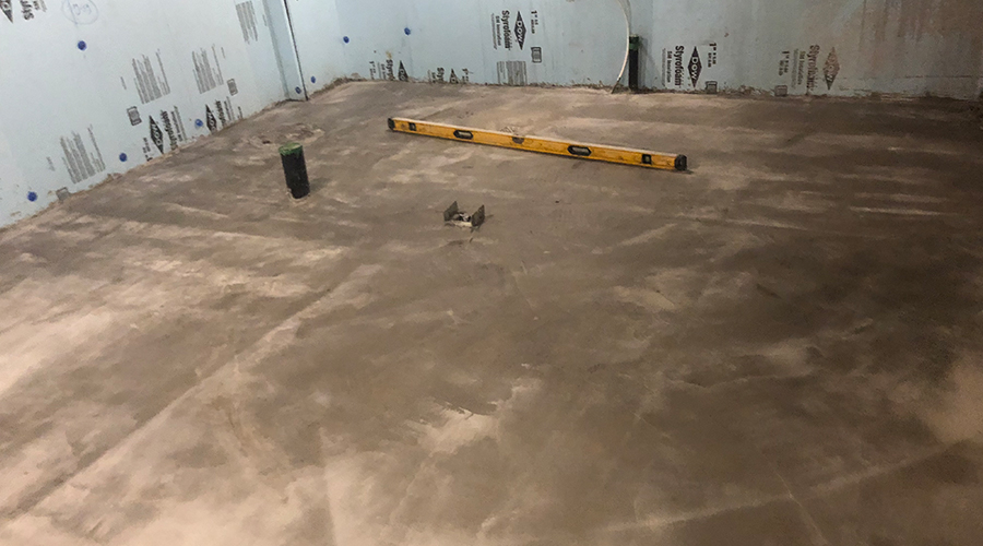 Basement with poured concrete under construction by Mace Masonry