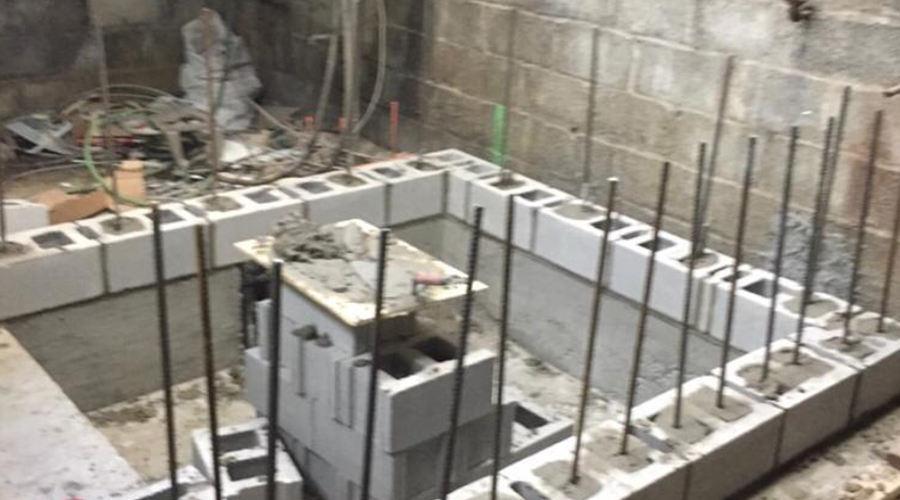 Cinderblock foundation under construction by Mace Masonry