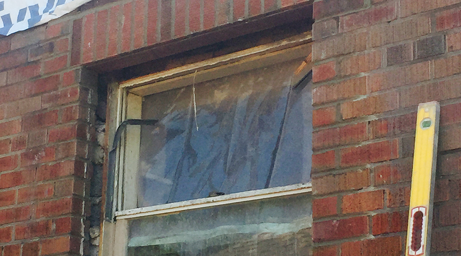 Old window with bricks repaired by Mace Masonry