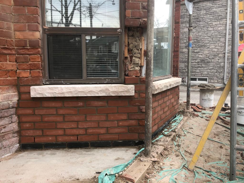 Historical restoration of an old building with many missing bricks